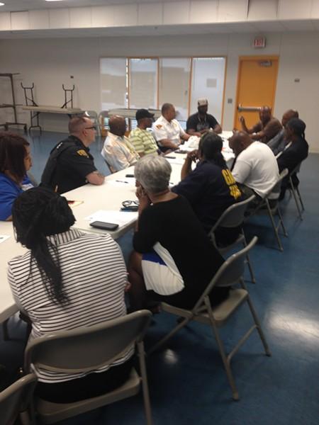 Reggie Rucker and Community Members, talking violence interruption pre-Brelo at the Zelma George Community Center - SAM ALLARD / SCENE