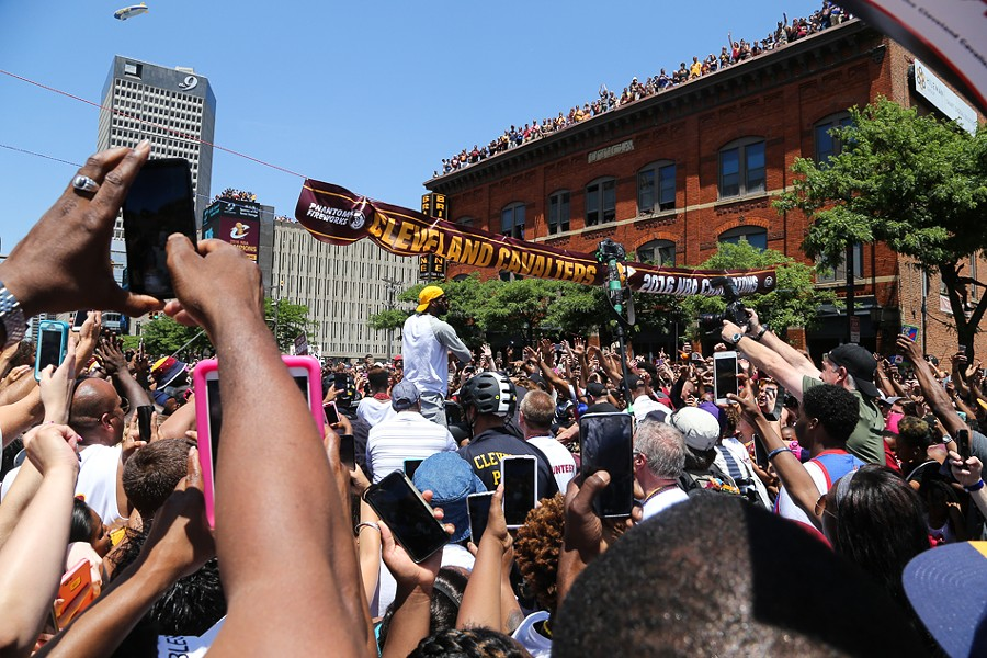 Crowds swarm LeBron James at the parade. - EMANUEL WALLACE / SCENE