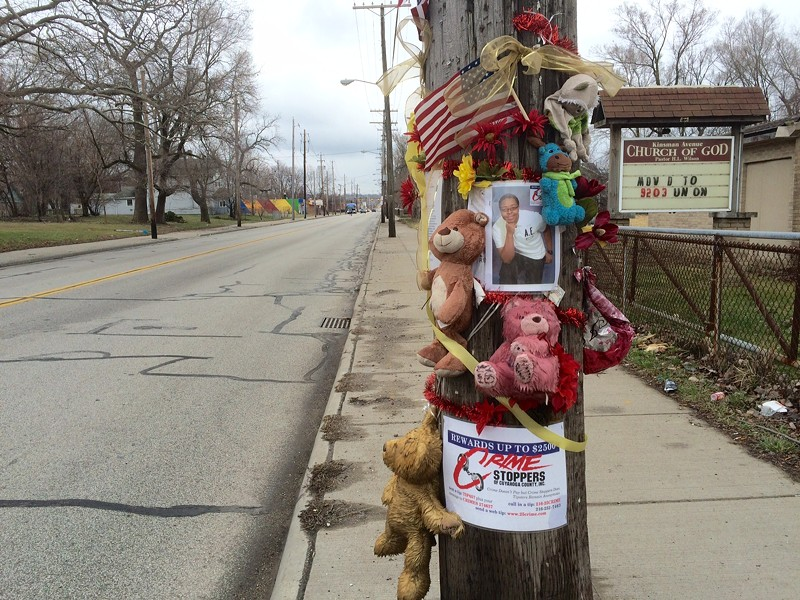 A memorial for another man killed in the neighborhood in 2016 rests just up the road from Sunday's crime scenes. - ERIC SANDY / SCENE