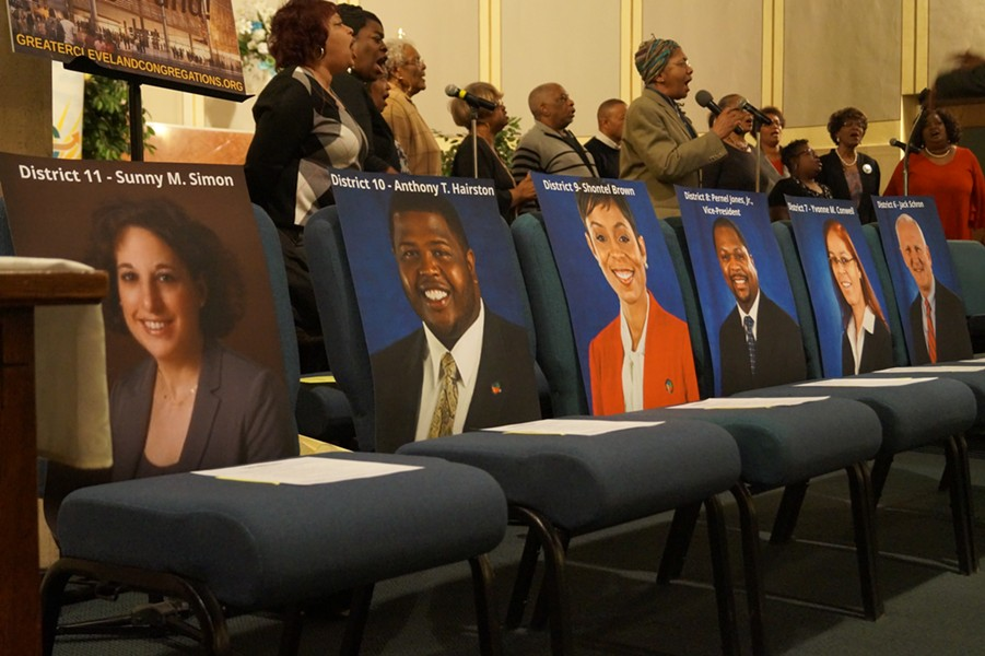 Pictures of County Councilpeople to mark their empty seats. (Both Yvonne Conwell and Jack Schron, along with the unpictured Dale Miler, eventually arrived). - SAM ALLARD / SCENE