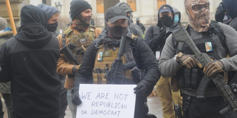 Armed men identifying themselves with the Boogaloo Movement stand outside the Ohio Capitol Jan. 17. Photo by Jake Zuckerman/OCJ.