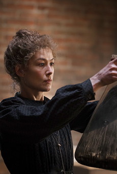 Rosamund Pike as Marie Curie in Radioactive