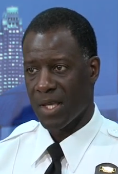 Police Chief Calvin Williams sheds tears as he discusses the recent shootings in Cleveland.