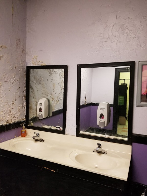 The first floor bathrooms before renovations - COURTESY OF AEG PRESENTS