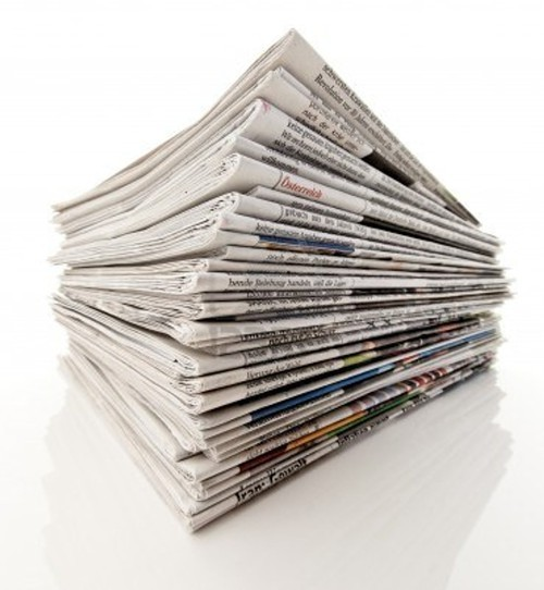 A stock photo of a stack of newspapers, not meant to be nostalgic.