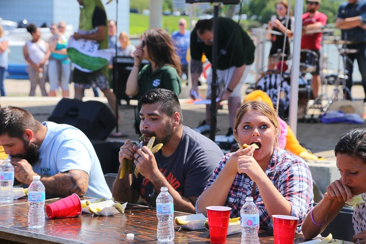People partake in last summer's pickle eating contest at the Cleveland Pickle Fest. - PHOTO BY EMANUEL WALLACE