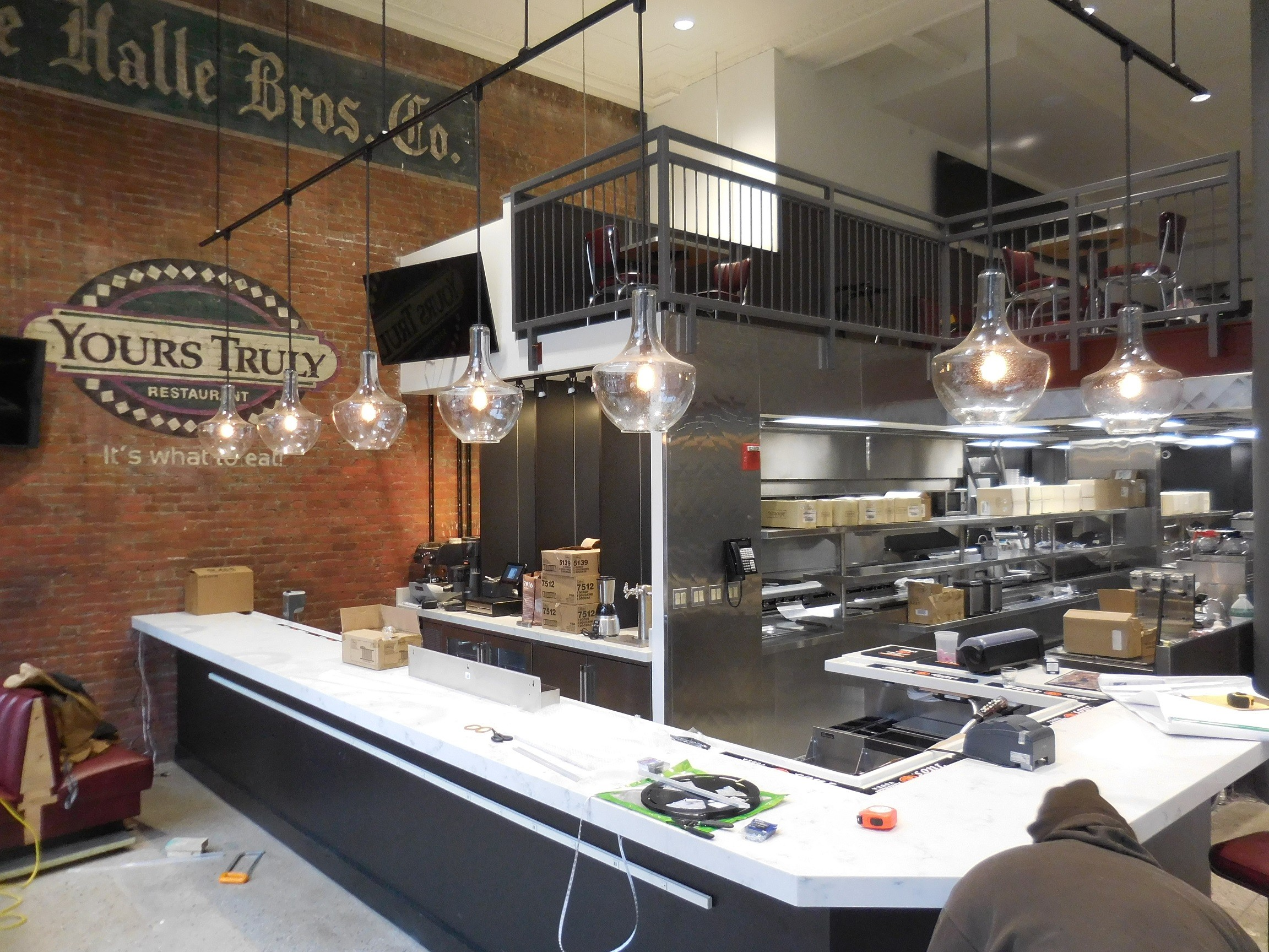 now open yours truly at the halle brothers co building scene and