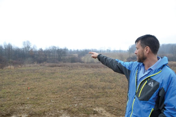 Vic Giaconia points out the proposed Nexus route, which would run alongside his property line.