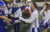 Video: Bay High School Football Team Honors Cheerleader Battling Cancer