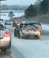 Here's a Guy Driving With His Top Down on I-77 During This Morning's Slow, Snowy Rush Hour
