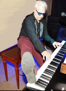 f2b6b95e_dave_holmberg_foot_on_piano.jpg