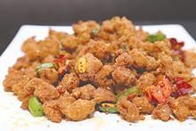 PHOTO BY EMANUEL WALLACE - Tian Fu Chicken in Szechuan oil