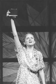 Violet (Lori Scarlett) waves farewell to her hometown.