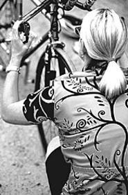 Women learn how to handle their ride at Bicycle - Survival & Maintenance 101.