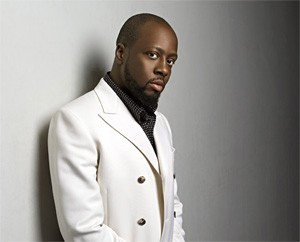 Wyclef contemplates asking Shakira for a painting or two.