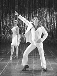 You can tell by the pose, hes in Saturday Night - Fever.