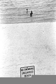 Young swimmers at Sims Beach, where a pipe releases raw sewage. - WALTER  NOVAK