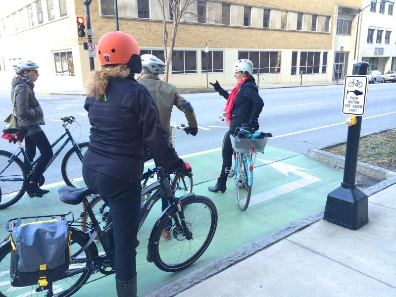 A dedicated bike signal and two stage turn helps 5th Street bike lane users cross West Peachtree Street.