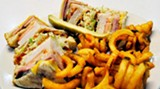 A delectable lunch: Henry's triple-decker club sandwich with curly fries