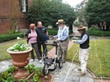 Archaeologist Rita Elliott (far right) documents radar analysis collected by her husband, Dan, (second from right) as visitors at the Davenport House look on.