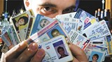 GEOFF L. JOHNSON - Bartender Pat Lawrence displays a collection of fake IDs confiscated from underage drinkers in Savannah.