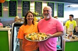 Business partners Paula Letcher and Johnny Baker stack the sandwiches high