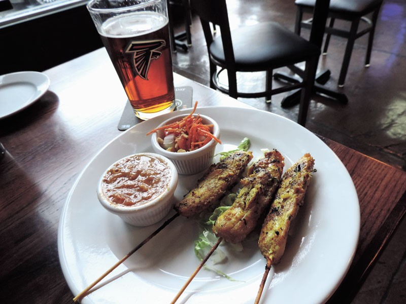 Chicken Satay w/sweet chili sauce & cucumber-carrot salad, accompanied by a cold draft beer.