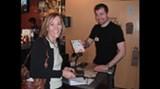 Christine Reddick gets her card stamped by Salt Table manager Steffan Legasse.