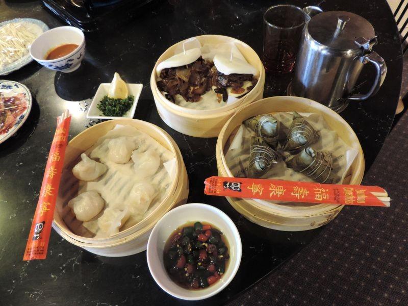 Clockwise from top: Hanbaobao (Chinese burgers), Zongzi, Mala sauce, Shrimp