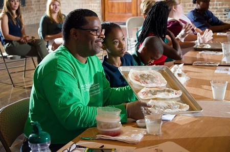 CRI Life Enhancement Program graduate Reginald Franklin and his children had fun helping their friends at the reunion make the recipe demonstrated by Meta Adler and Chef Michele Jemison from Savannah's Dept. 7 East. Photo by James Byous, © Canyon Ranch Institute.