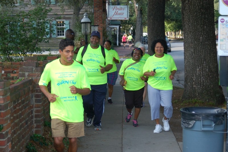 CRI Life Enhancement Program participants follow Palmer Steverson (left) on one of their Saturday Walking Club trips around historic Savannah. Behind Palmer are participants Reginald Franklin and Glennis Cadle, and Core Team Lead Carolyn Eiland (right).