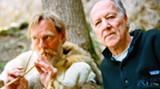 Director Werner Herzog, right, with Wulf Hein playing a prehistoric flute