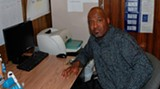 Executive Director Mark Douglas in the testing room at the My Brothaz Home facility