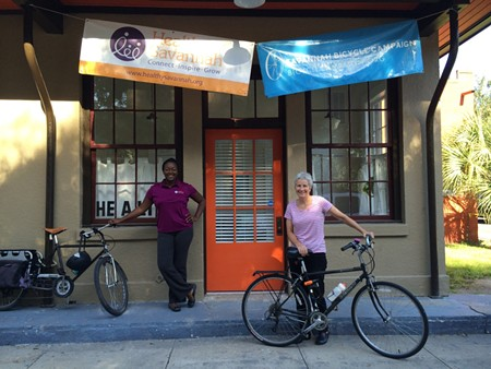 """Healthy Savannah Director and self-described health """"nut"""" Paula Kreissler (right) works tirelessly to promote wellness. Shown here outside the Healthy Savannah office with Morphia Scarlett (left), Assistant Director of Healthy Living and Community Development. Photo courtesy of Healthy Savannah."""