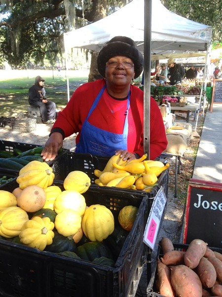 Helen Fields of Joseph Fields Farm has a welcome smile for everyone who visits her display of organic produce at Forsyth Farmers' Market.