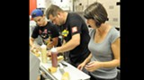 How many people does it take to make a gourmet hot dog?
