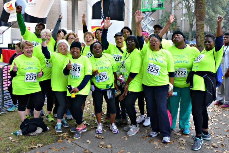 """If you've ever finished a group run or walk, you know how exciting it is when you reach the finish line. And, it's even more fun when you find your fellow """"athletes"""" from the group and celebrate with a hug and a thumbs-up for all!"""