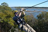 Jeremy Childers zips above Broad Creek at Zipline Hilton Head
