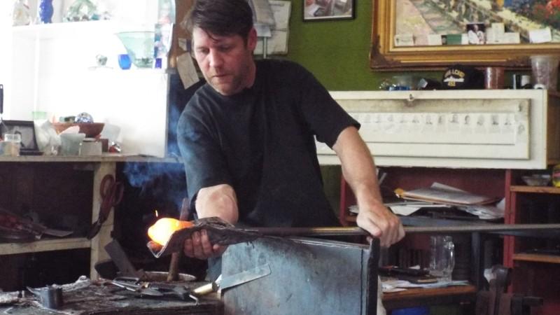 Jonathan Poirier making an olive oil bottle; his furnace runs at 2,000 degrees.