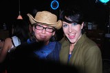 Kudos to Savannah Music Festival founder Kayne Lanahan (left), seen here on a typically crazy and crowded Stopover night with Angel Bond from the band Cusses.
