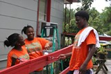 (L to R) Breane Flowers, Jacqunette Robinson and Darius Capers have spent the summer with the City of Savannah's Pre-Apprentice Program, a multi-pronged approach to providing education and experience to teens.Marquan Brown spruces up the trim of a home belonging to a senior citizen as part of his internship.