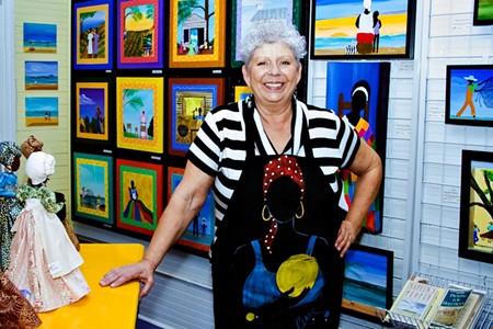 Local artist Samantha Claar in her City Market gallery space during Savannah Art Walk. - NUNO SERRANO