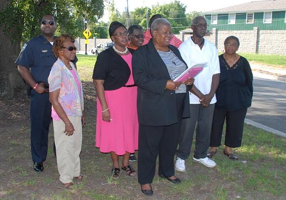 Betty Jones, Feiler Park Neighborhood Association President, reads from her text at Thursday afternoon rally