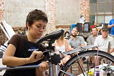 New Standard Cycles Manager Jen Colestock teaching a bike maintenance class.