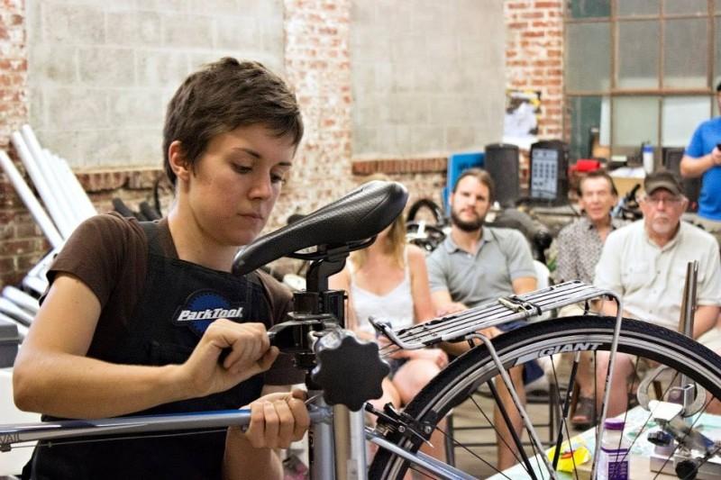 New Standard Cycles Manager Jen Colestock teaching a bike maintenance class.