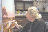 Painter William Armstrong at work.