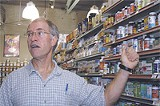 Peter Brodhead, cofounder and co-owner of Brighter Day Natural Foods, in the supplements section