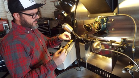 Philip Brown keeps a watchful eye on the coffee roasting process at PERC's new-ish digs on East Broad.