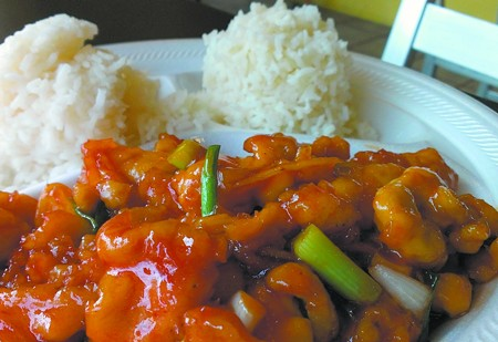 PJ Thai's piping hot Orange Chicken keeps a palate interested with plenty of spicy ginger and green onions. - PHOTO BY TIM RUTHERFORD