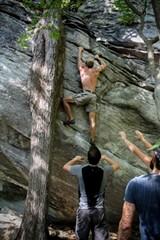 Russ Bonham of the Savannah Climbing Coop scales the Rumbling Bald boulder field near Asheville, NC.